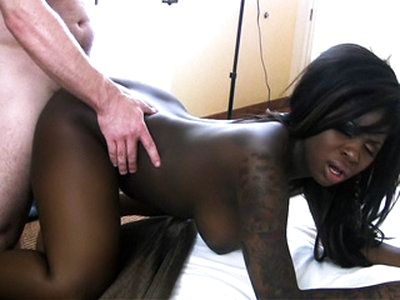 Splendid tattooed ebony chick with humongous tits Tatiyana Foxx gets a wild nasty fuck inside a hotel room