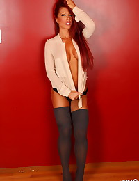 Alluring Vixen babe Shanna teases with her big tits in an open dress shirt and knee high socks