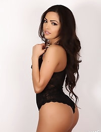 Busty Alluring Vixen Karla shows off her round perfect ass in a sexy little black lace outfit photo #4